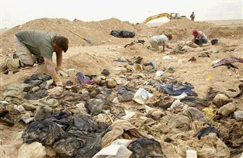 (FILES) Forensic specialists work at a mass grave ...